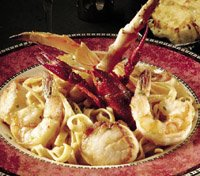 Seafood Pasta with shrimp, crab & scallops in sherry cream sauce.