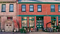 the front of historic brick buildings housing antique shops.