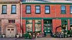 the front of historic brick buildings housing antique shops.