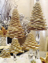 holiday cookies stacked up in the shape of Christmas trees.