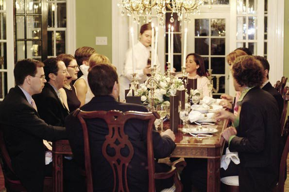 an elegant group of guests seated for dinner
