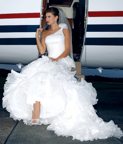 La Sposa gown, $1,869; Winters & Rain veil, $255; Love heels, $178. Simply Elegant Bridal. Ella Gem South Sea cultured-pearl–and–diamond earrings, price upon request. Elleard Heffern Fine Jewelers.