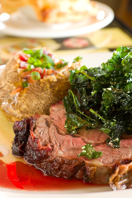 Flash-fried spinach atop smoked prime rib