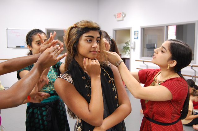 Selena Swaminathan (as heroine Vidya) getting her hair done.