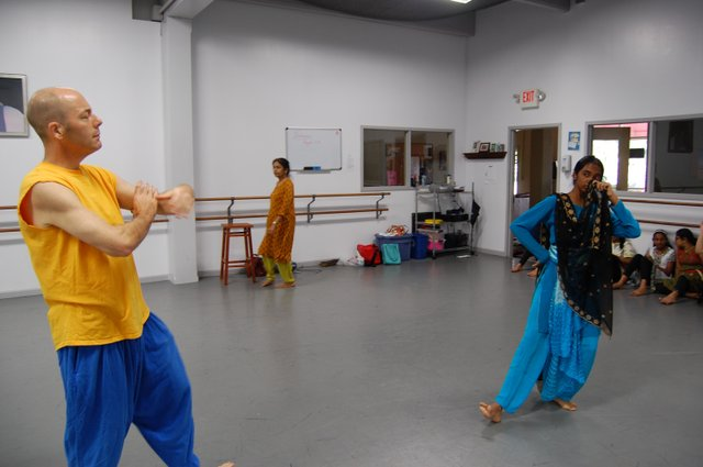 Matthew Traeger dances with the stepsister Swathi Iyer.