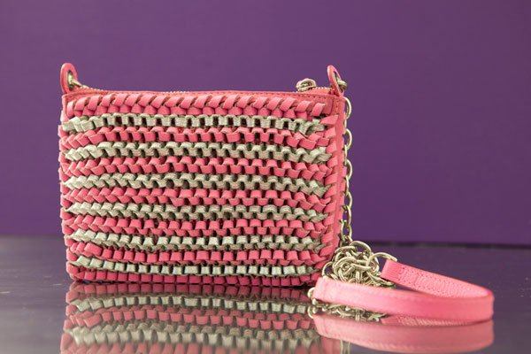 "Diane Von Furstenberg, ""Mini Stephanie"" pink and silver woven leather clutch with silver chain"