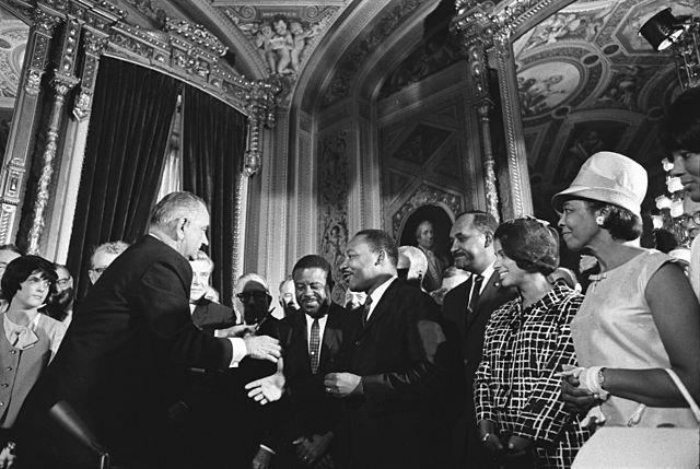 640px-Lyndon_Johnson_and_Martin_Luther_King_Jr._-_Voting_Rights_Act.jpg