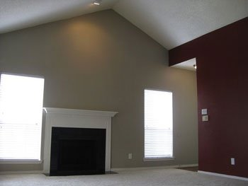 How to decorate a large wall space on a budget st louis for How to paint a vaulted ceiling room