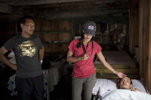 Esguerra checks on a villager complaining of severe chest pain at a guesthouse in Dharapani.