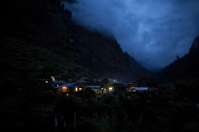 Clouds roll in over Tilche as volunteers hike back to the guesthouses. The village sits at approximately 7,300 feet above sea level.