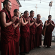 Tibetan monks give a blessing at The Royale.png