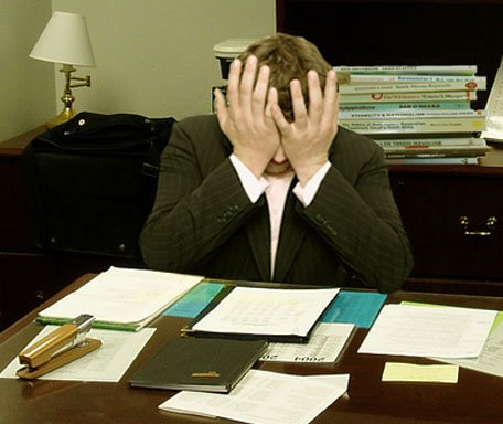 Frustrated_man_at_a_desk_(cropped).jpg