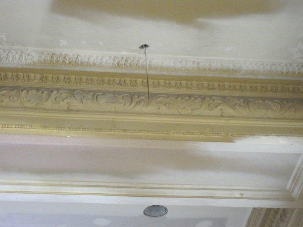 Plaster frieze under restoration.jpg