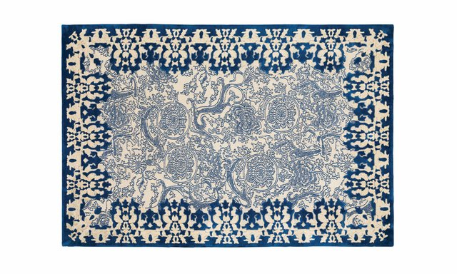 cobalt_motif_hand_knotted_tibetan_wool_area_rug_with_raised_silk_border.jpg