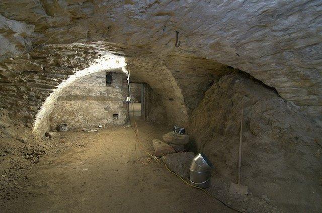 Basement lagering cellar under old brew house looking west.jpg