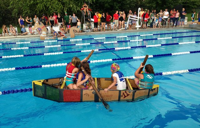 At Annual Race Kids Compete In Boats Made Of Cardboard And Duct Tape