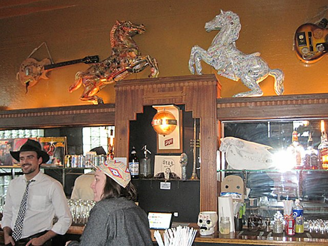 The Livry carousel horses over bar.jpg