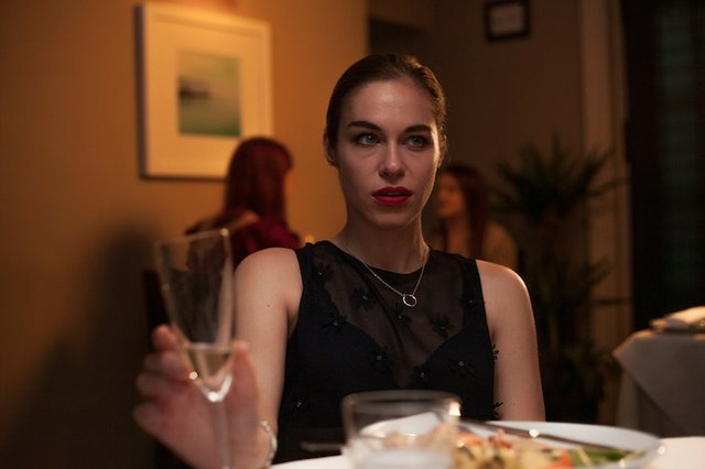 Holly (Kirsty Averton) at dinner with Marvin