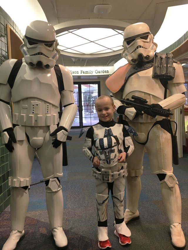 St. Louis Children's Hospital - Painted Masks for Proton Therapy to Treat Pediatric Brain Tumors - Evan and Storm Troopers with his Mask 1.JPG