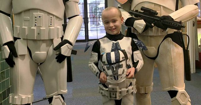 St.-Louis-Children's-Hospital---Painted-Masks-for-Proton-Therapy-to-Treat-Pediatric-Brain-Tumors---Evan-and-Storm-Troopers-with-his-Mask-1.jpg