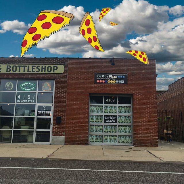 exterior of shop with flying pizza slices.jpg