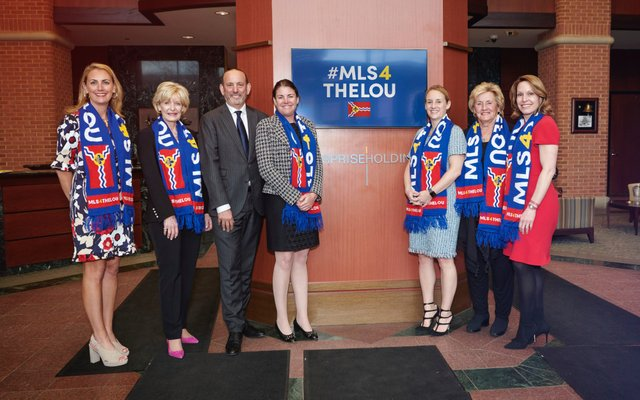 Taylor Family and Commissioner Don Garber.jpg
