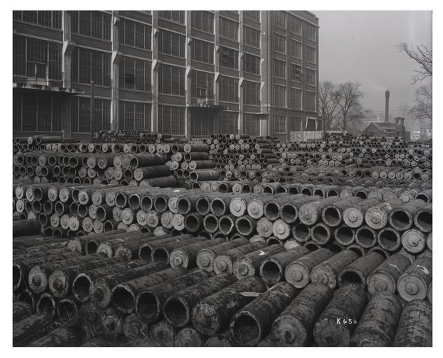 View of Artillery Shells Piled Up Outside of Wagner Electric Building, December 18, 1918 Missouri History Museum, P0244-K0656.jpg