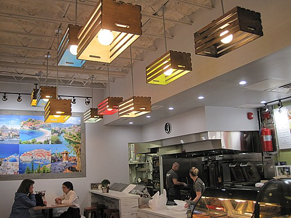 int view of light fixtures and back wall collage.jpg