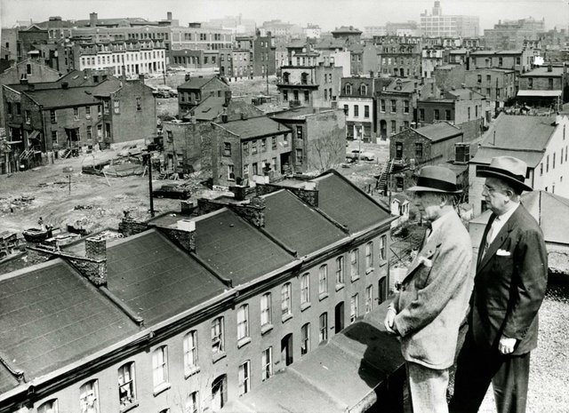 SIDNEY MAESTRE AND MAYOR RAYMOND TUCKER ON ROOFTOP OVERLOOKING AREA OF MILL CREEK VALLEY SLATED FOR CLEARANCE.1956, Missouri History Museum, N20908.jpg