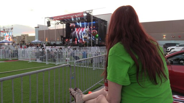 Woman watching concert from car.jpg