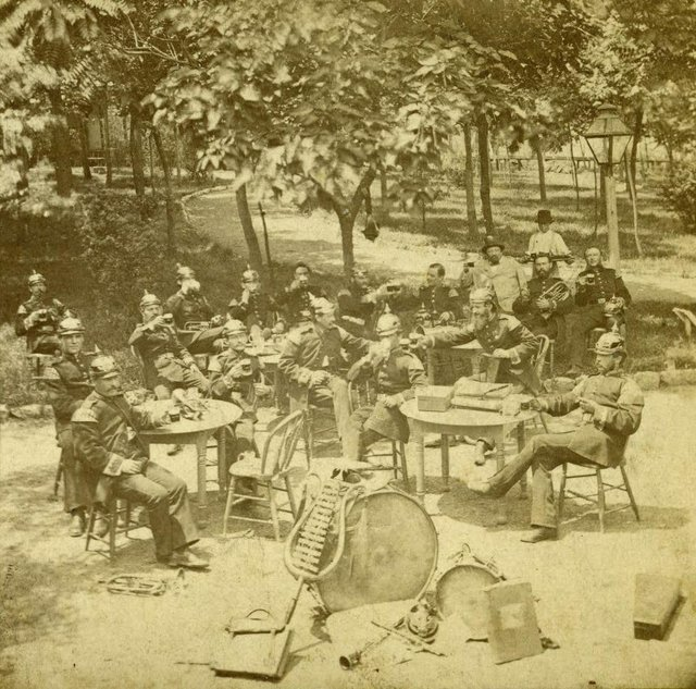 Band Members Seated at Tables at Schnaider's Garden, c. 1870, Photograph by A. Rino, Missouri History Museum, N35916.jpg